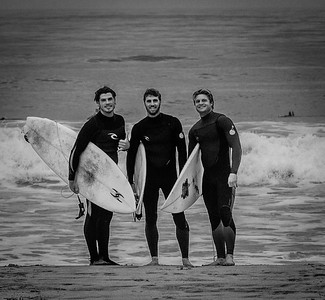 Three happy surfers at El Porto, Manhattan Beach.
