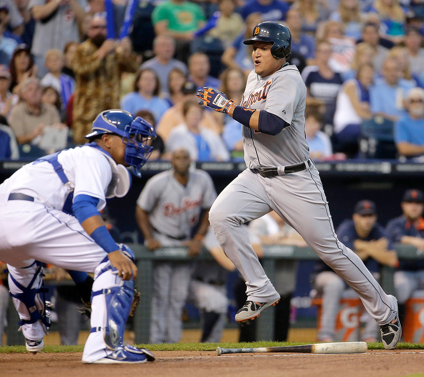 . Detroit Tigers\' Miguel Cabrera runs home past Kansas City Royals catcher Salvador Perez to score on a single by Victory Martinez during the first inning of a baseball game Friday, Sept. 19, 2014, in Kansas City, Mo. (AP Photo/Charlie Riedel)