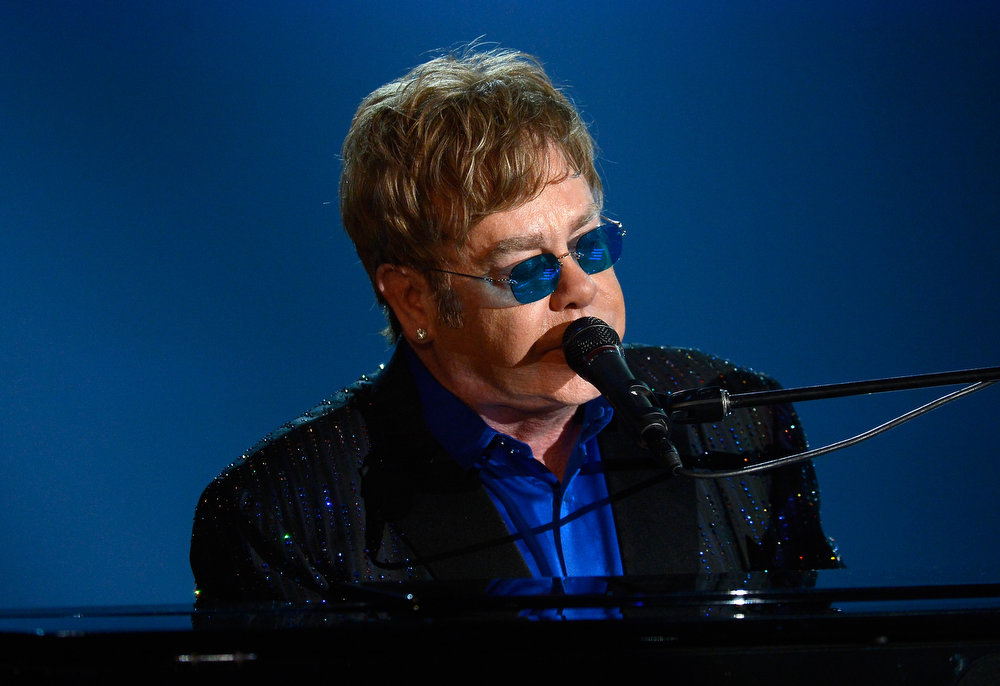 Description of . Musician Sir Elton John performs onstage at the 55th Annual GRAMMY Awards at Staples Center on February 10, 2013 in Los Angeles, California.  (Photo by Kevork Djansezian/Getty Images)