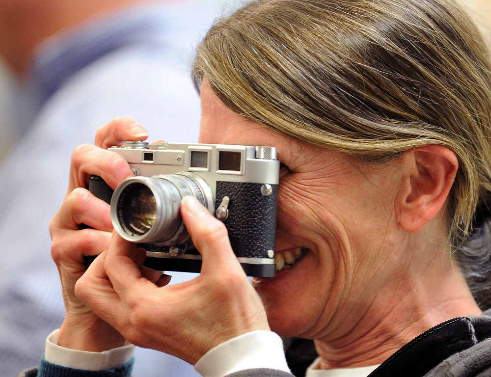 . Karen Heller of Piedmont, takes photos during a farewell event for Sarber\'s Cameras in Oakland, Calif., on Friday, Feb. 1, 2013. The store was bought in 1961 by Peter and Nancy Sarber and moved to Montclair in 1964. After more than a half-century in business, Sarber\'s Cameras is closing. The Sarber family held the farewell event for longtime customers, friends and family in Montclair Village. (Doug Duran/Staff)