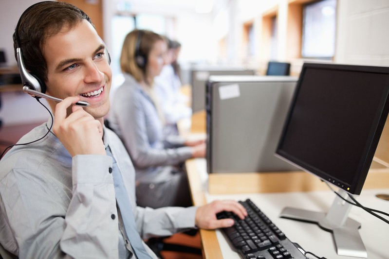 11183667 - smiling assistant using a headset in a call center