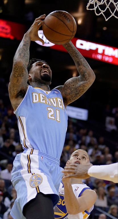 . Denver Nuggets\' Wilson Chandler (21) shoots over Golden State Warriors\' Stephen Curry during the first half of an NBA basketball game Wednesday, Jan. 15, 2014, in Oakland, Calif. (AP Photo/Ben Margot)