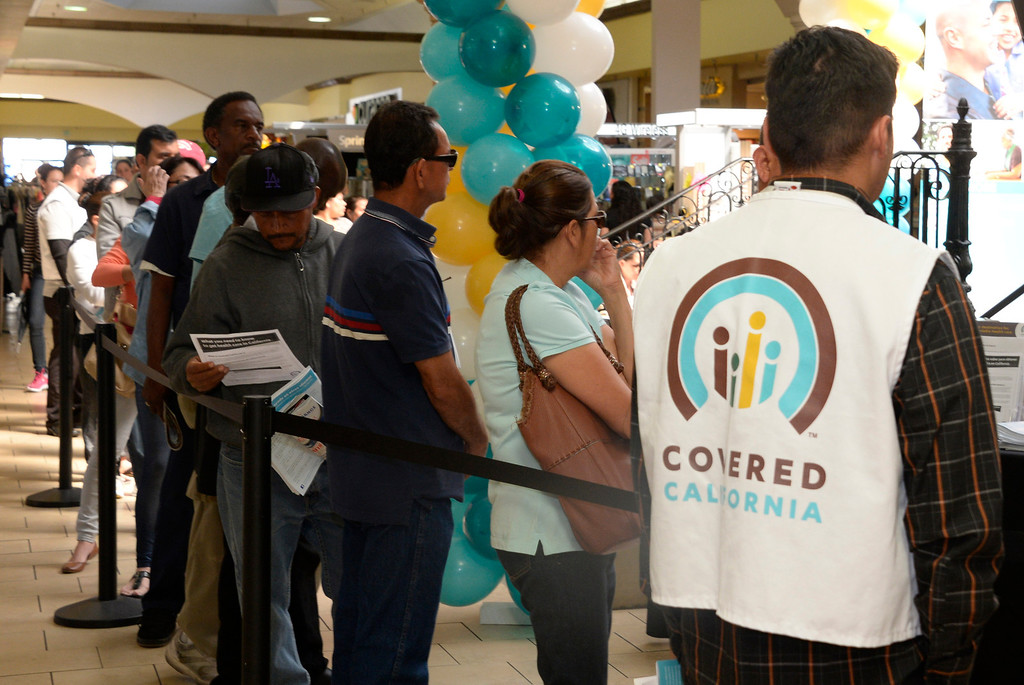 . Potential registrants wait in line to talk to enrollment counselors at the Panorama Mall in Panorama City, Calif., on Friday, March 28, 2014 regarding health care plans available through Covered California, a state health care exchange. Monday, March 31, is the deadline to enroll for this year. (Photo by Gene Blevins/Los Angeles Daily News)