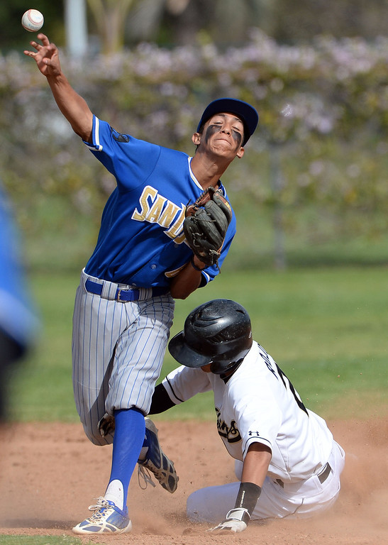 . San Dimas second baseman Matt Corona (6) forces out Northview\'s Zack Rojo (2) at second base in the third inning of a prep baseball game at Northview High School in Covina, Calif., on Wednesday, March 26, 2014. San Dimas won 2-0. (Keith Birmingham Pasadena Star-News)