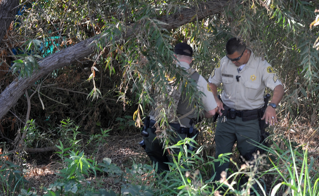 . Los Angeles County Sheriff\'s Deputies and several County agencies search for homeless individuals camping in the river bed area of the San Gabriel River near South El Monte on Thursday September 12, 2013. (Whittier Daily News/Staff Photo by Keith Durflinger)