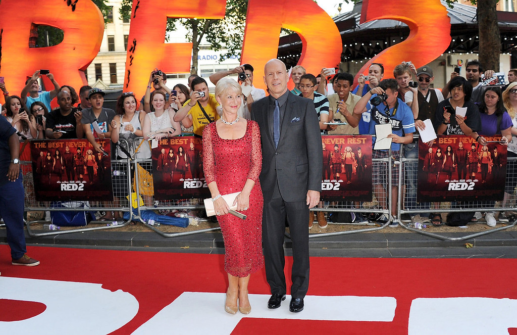 . Dame Helen Mirren and Bruce Willis attends the European Premiere of \'Red 2\' at Empire Leicester Square on July 22, 2013 in London, England.  (Photo by Stuart C. Wilson/Getty Images)