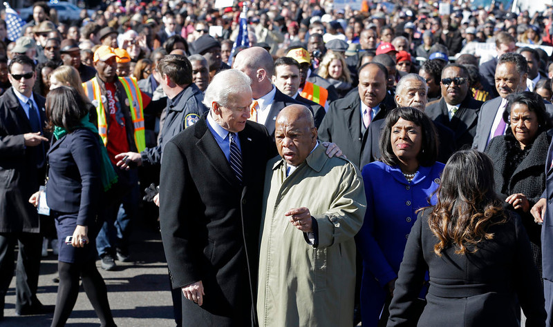 . Vice President Joe Biden embraces U.S. Rep. John Lewis, D-Ga., as they prepare to lead a group across the Edmund Pettus Bridge in Selma, Ala., Sunday, March 3, 2013. They were commemorating the 48th anniversary of Bloody Sunday, when police officers beat marchers when they crossed the bridge on a march from Selma to Montgomery. (AP Photo/Dave Martin)