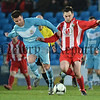©Press Eye Ltd Northern Ireland -12th January 2023<br /> Irish cup fifth round match between Ballymena United and Warrenpoint at Warden street  Ballymena.<br /> Ballymena's ALan Davidson  in action with Warrenpoints Patrick Mooney<br /> Mandatory Credit - Picture by Stephen Hamilton/Presseye.com