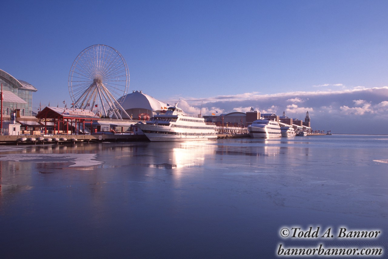 Navy Pier in winter. Chicago, Illinois, USA. Ferris wheel and excursion boats. This image was shot on film in the mid 1990s.