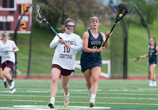 05/10/19 Wesley Bunnell | Staff Newington girls lacrosse defeated Bristol Central in an away game at Bristol Central High School on Friday afternoon. Bristol Central's (10) Newington's Taylor D'Anna (8).