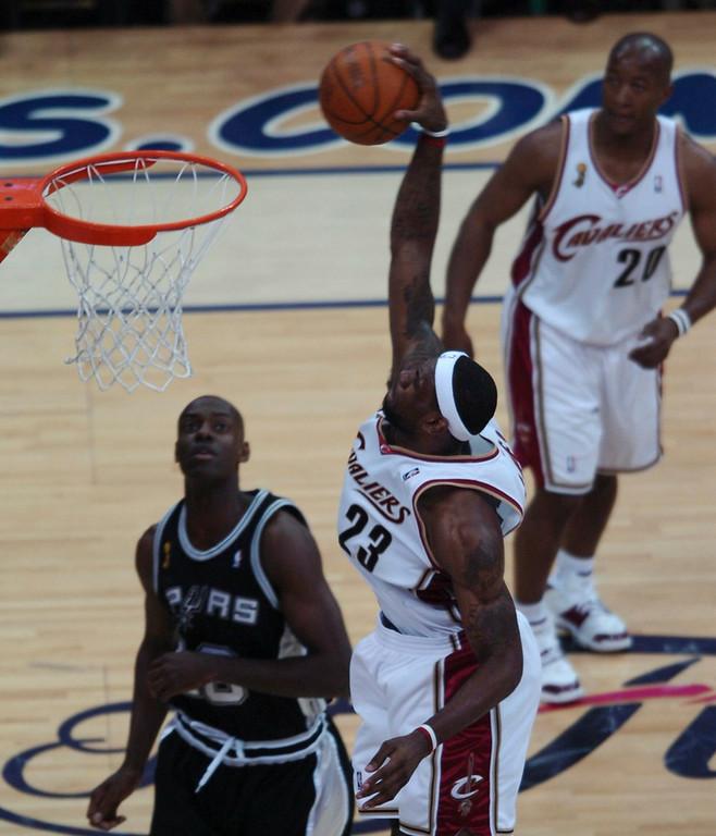 . MORNING JOURNAL/DAVID RICHARD LeBron James slam dunks over Francisco Elson last night.