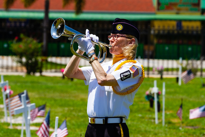 Christine Morales, a member of the Honor Guard of American Legion Post 164, plays Taps on her bugle during the Memorial Day Observance at Boynton Beach Memorial Park on Sunday, May 26, 2019. [JOSEPH FORZANO/palmbeachpost.com]