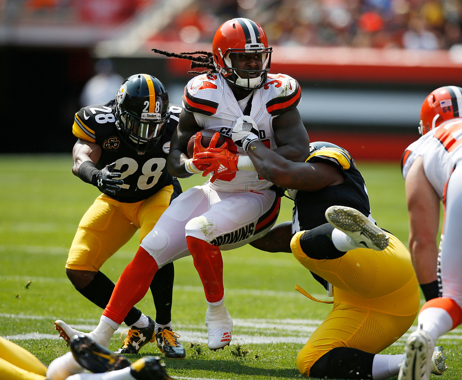 . Cleveland Browns running back Isaiah Crowell (34) is stopped by Pittsburgh Steelers defense during the first half of an NFL football game, Sunday, Sept. 10, 2017, in Cleveland. (AP Photo/Ron Schwane)