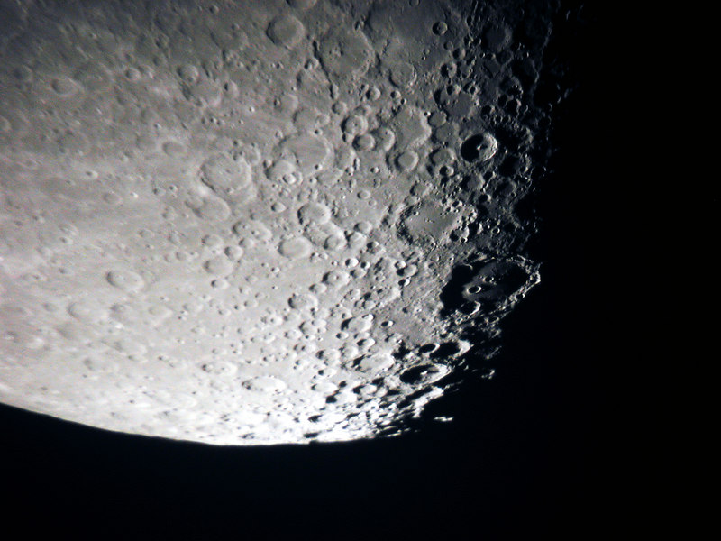 """Southern portion of the moon taken May 6, 2006 at approx. 11:00 PM EST. In this image, taken by myself; Clavius is easily visible as the largest crater shown here  with Clavius """"C"""" and """"D"""" inside. Rutherford - a 32 by 29 mile crater just touches the southeastern wall; while the crater Porter is barely visible along the northeast rim of Clavius due to the steep sun angle.   Tyco's central peak is well illuminated in the northerly part of this image; being 1,500 meters tall. Another interesting peak occurs in the Moretus crater to the south of Clavius; this one is 2700 meters in height.  Specifications. Moon phase 69.2%. Illumination 67.8%. Apparent diameter of the moon 29.85'. Taken with 12 inch Reflector Telescope, at approx. 120 x Vixen Lathanum eyepiece. Camera Nikon 990 set at 1/60 sec f 3.2."""