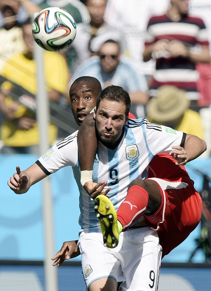 . Switzerland\'s defender Johan Djourou (L) and Argentina\'s forward Gonzalo Higuain (front) vie for the ball during a Round of 16 football match between Argentina and Switzerland at Corinthians Arena in Sao Paulo during the 2014 FIFA World Cup on July 1, 2014.  (JUAN MABROMATA/AFP/Getty Images)