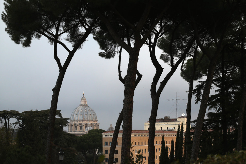 Description of . The Basilica in Saint Peter's Square is seen between trees on February 24, 2013 in Rome, Italy. The Pontiff will hold his last weekly public audience on February 27, 2013 before he retires the following day. Pope Benedict XVI has been the leader of the Catholic Church for eight years and is the first Pope to retire since 1415. He cites ailing health as his reason for retirement and will spend the rest of his life in solitude away from public engagements.  (Photo by Oli Scarff/Getty Images)