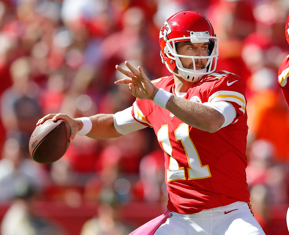 . Kansas City Chiefs quarterback Alex Smith (11) passes to a teammate during the first half of an NFL football game against the Oakland Raiders at Arrowhead Stadium in Kansas City, Mo., Sunday, Oct. 13, 2013. (AP Photo/Ed Zurga)