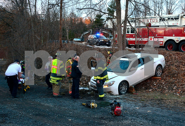 12/20/2017 Mike Orazzi | Staff The scene of a one vehicle crash on Barlow Street near Terryville Road Wednesday afternoon. The driver was transported from the scene with an apparent head injury.