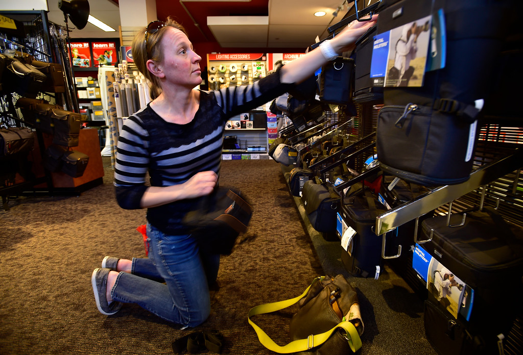 . BOULDER, CO. NOVEMBER 14, 2018 Julie Hinckley looks for a camera bag at Mike\'s Camera in Boulder on Wednesday morning.  (Photo by Paul Aiken/Staff Photographer)