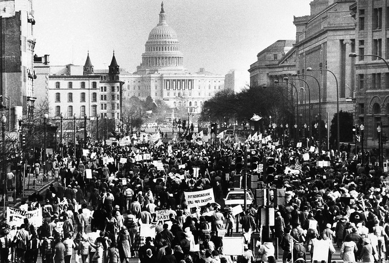 . Several thousand marchers, protesting the 8-year-old Supreme Court decision permitting abortions, march down Pennsylvania  Avenue in Washington toward the U.S. Capitol building Jan. 22, 1981. (AP Photo/Herbert K. White)