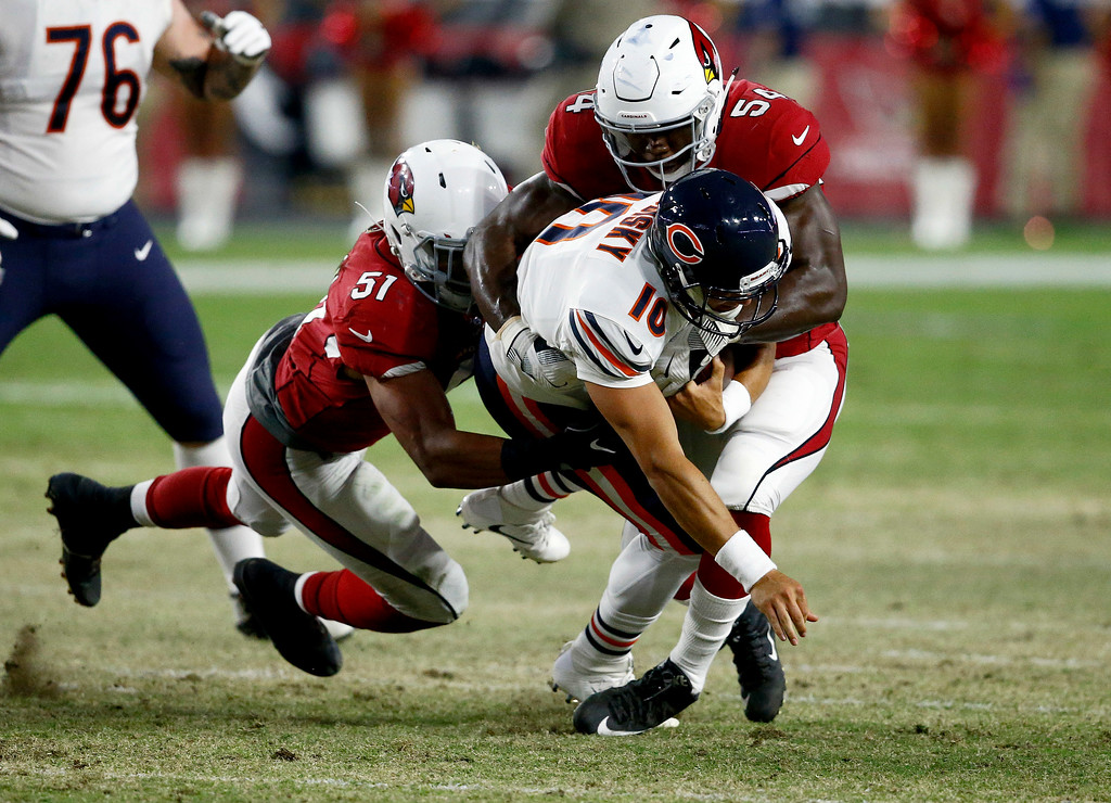 . Chicago Bears quarterback Mitchell Trubisky (10) is sacked by Arizona Cardinals linebacker Alex Bazzie, right, and linebacker Tre\'Von Johnson (51) during the second half of a preseason NFL football game, Saturday, Aug. 19, 2017, in Glendale, Ariz. (AP Photo/Ross D. Franklin)