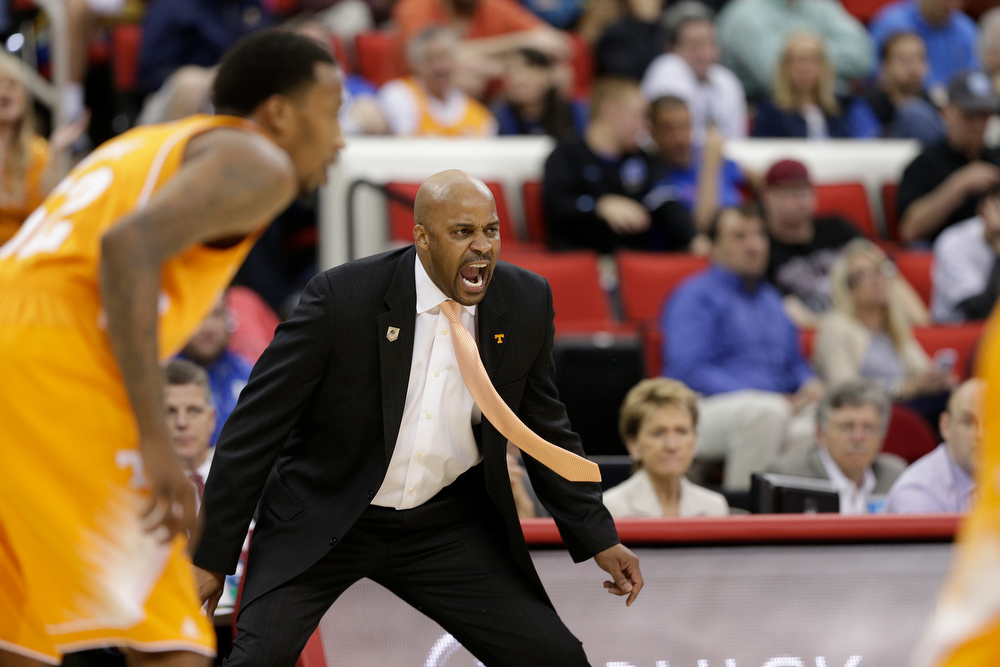 . Tennessee head coach Cuonzo Martin speaks to players against Massachusetts during the first half of an NCAA college basketball second-round tournament game, Friday, March 21, 2014, in Raleigh. (AP Photo/Chuck Burton)