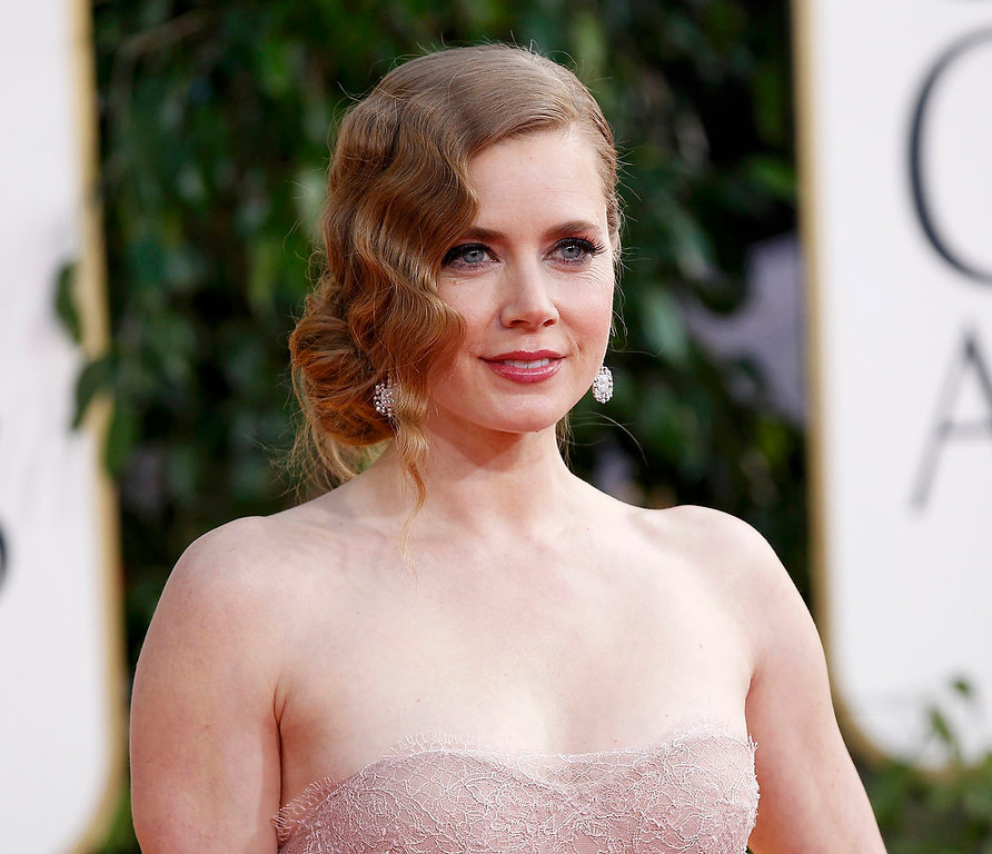 ". Actress Amy Adams, from the film ""The Master,\"" arrives at the 70th annual Golden Globe Awards in Beverly Hills, California, January 13, 2013.   REUTERS/Mario Anzuoni"