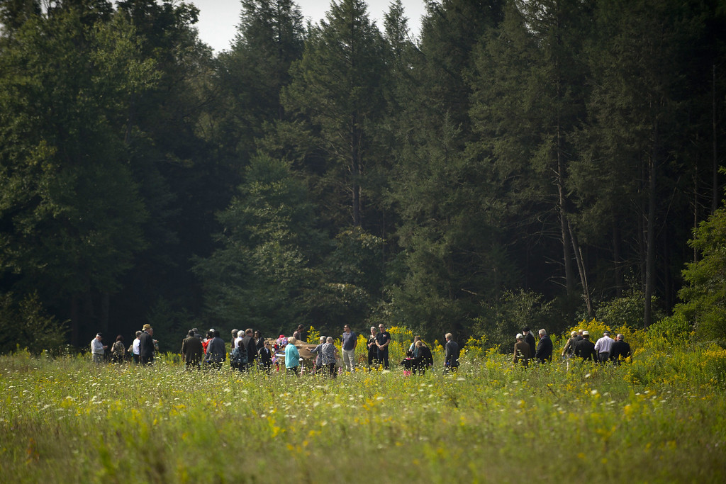 . Family members of the victims gather together around the plane crash site at the Flight 93 National Memorial during ceremonies commemorating the 12th anniversary of the 9/11 attacks on September 11, 2013 in Shanksville, Pennsylvania.  (Photo by Jeff Swensen/Getty Images)
