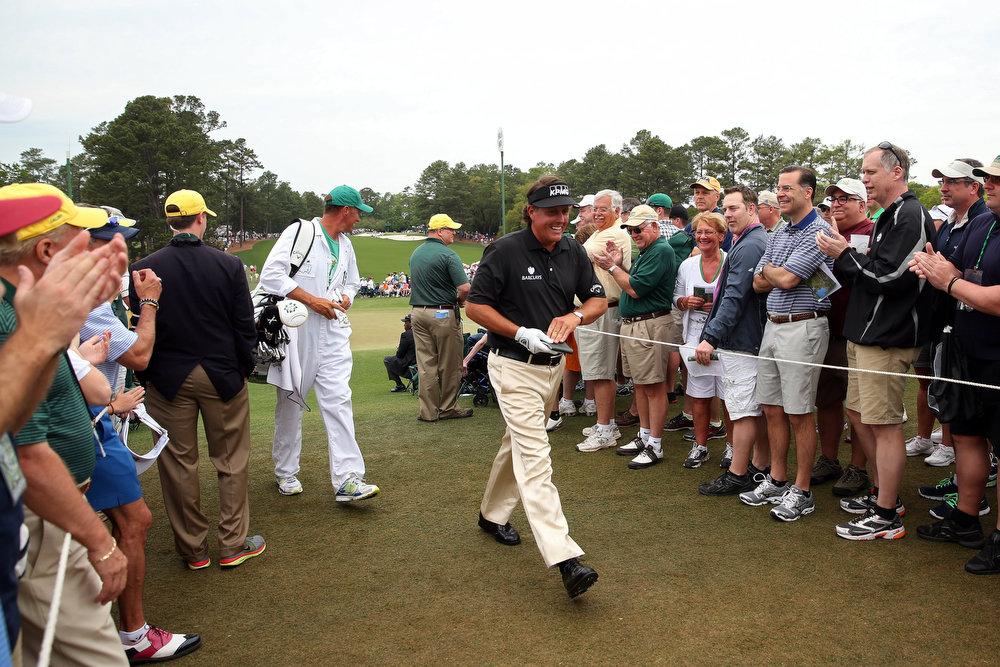 Description of . Phil Mickelson of the United States walks through as patrons clap during the final round of the 2013 Masters Tournament at Augusta National Golf Club on April 14, 2013 in Augusta, Georgia.  (Photo by Andrew Redington/Getty Images)
