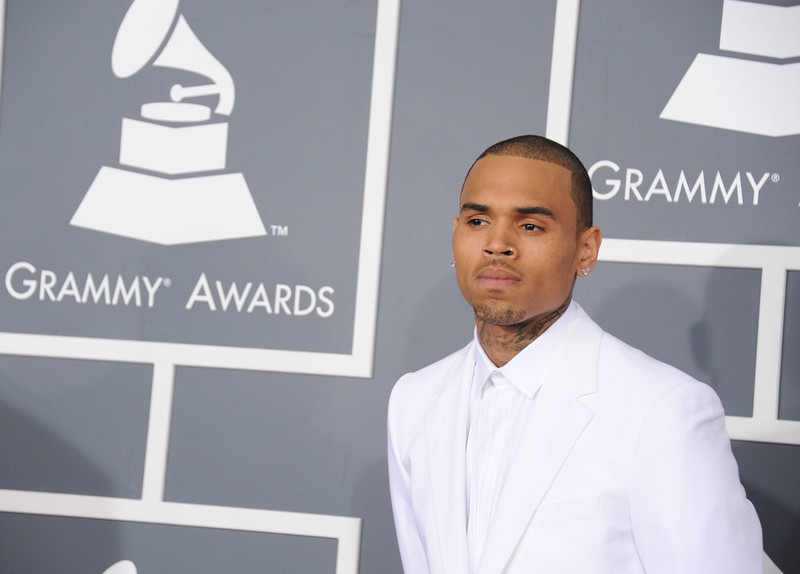 . Chris Brown arrives at the 55th annual Grammy Awards on Sunday, Feb. 10, 2013, in Los Angeles.  (Photo by Jordan Strauss/Invision/AP)