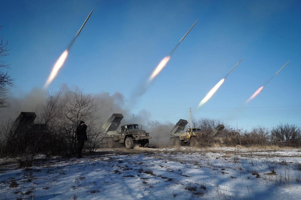""". Pro-Russian rebels stationed in the eastern Ukrainian city of Gorlivka, Donetsk region, launch missiles from Grad launch vehicles on February 18, 2015. Ukrainian troops pulled out of the hotspot eastern town of Debaltseve after it was stormed by pro-Russian rebels in what the EU said was a \""""clear violation\"""" of an internationally-backed truce. ANDREY BORODULIN/AFP/Getty Images"""