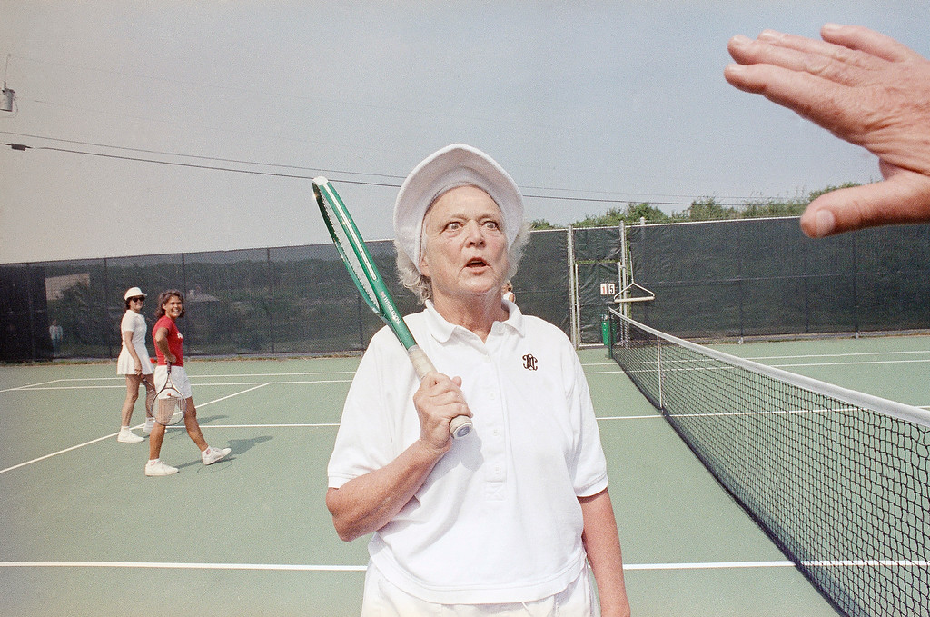 """. First lady Barbara Bush pokes fun at herself by crossing her eyes for reporters who were visiting the summer White House in Kennebunkport, Maine, August 23, 1989. When asked about her health and recent treatment for Graves\'s disease, which affects her vision, Mrs. Bush replied, """"I want you to see my eye\'s are just fine."""" (AP Photo/Pat Wellenbach)"""