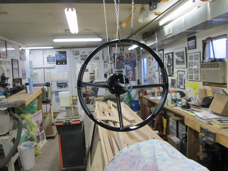 Front view of steering wheel being painted.
