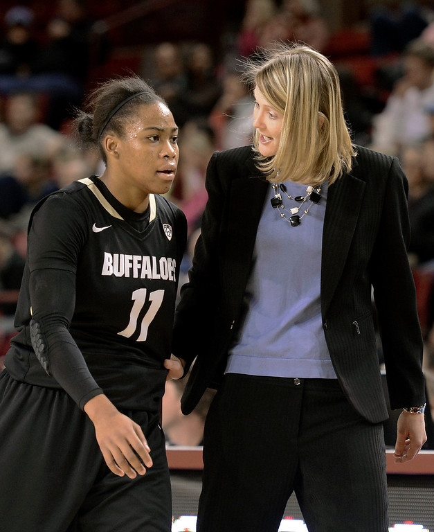 . University of Colorado head coach Linda Lappe talks with Brittany Wilson on the sideline during a games against the University of Denver on Tuesday, Dec. 11, at the Magnus Arena on the DU campus in Denver.   (Jeremy Papasso/Daily Camera)