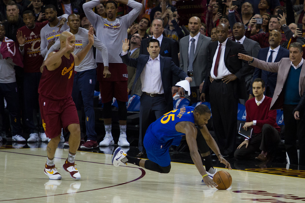 . Kevin Durant (35) of the Golden State Warriors trips during the last three seconds of the game to lose to the Cavaliers at the Quicken Loans Arena on Christmas day.  The Cavs defeated the Warriors 109-108.  Michael Johnson - The News Herald