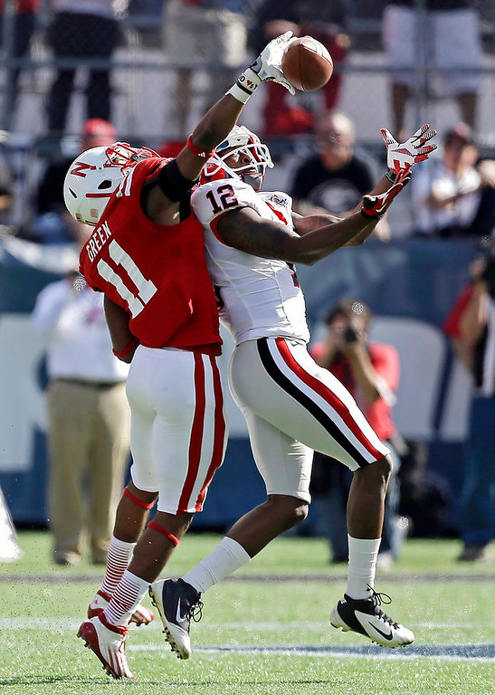 . Georgia wide receiver Tavarres King (12) catches a pass in front of Nebraska cornerback Andrew Green (11) for a 75-yard touchdown play during the first half of the Capital One Bowl NCAA football game, Tuesday, Jan. 1, 2013, in Orlando, Fla. (AP Photo/John Raoux)