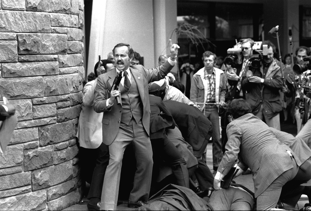 . In this March 30, 1981 file photo, an unidentified secret agent, automatic weapon drawn, yells orders after shots were fired at President Ronald Reagan Monday, March 30, 1981, outside a Washington hotel.    A newly released Secret Service audiotape from the attempted assassination of Ronald Reagan sheds lights on the chaotic aftermath when neither the president nor his agents realized he�d been shot.  (AP Photo/Ron Edmonds)