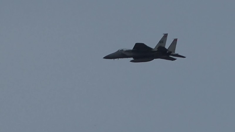 2-28-18...two F-15s doing low approaches after lead ships landed...shot from lumberyard mound