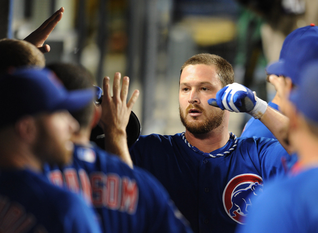 . Cubs Travis Wood is congratulated in the 3rd inning after being driven in by Dioner Navarro. The Cubs were in town to play the Dodgers. Los Angeles, CA. 8/24/2013(John McCoy/LA Daily News)