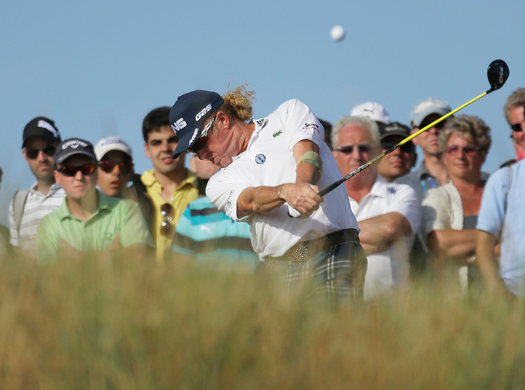 . Miguel Angel Jimenez of Spain plays a shot off the 14th tee during the third round of the British Open Golf Championship at Muirfield, Scotland, Saturday July 20, 2013. (AP Photo/Jon Super)