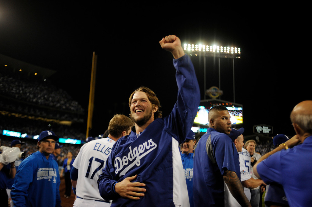 . The Dodgers\'  Clayton Kershaw raises his fist in the air after beating  the Atlanta Braves during game 4 of the NLDS at Dodger Stadium Monday, October 7, 2013. The Dodgers beat the Braves 4-3.(Photo by Hans Gutknecht/Los Angeles Daily News)