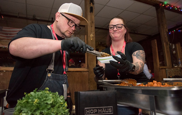 11/19/19 Wesley Bunnell | StaffrrJakub Gorgon, L, and Katie Kennedy work the Hop Haus table during the Southington Chamber of Commerce's annual WingFest at the Cadillac Ranch on Monday night November 18 , 2019.