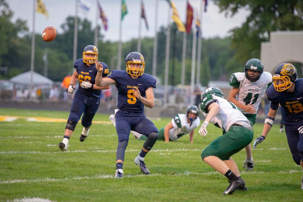 . Aimee Bielozer - The Morning Journal<br> Olmsted Falls quarterback Teddy Grendzynski pitches the ball against Westlake on Sept. 7.