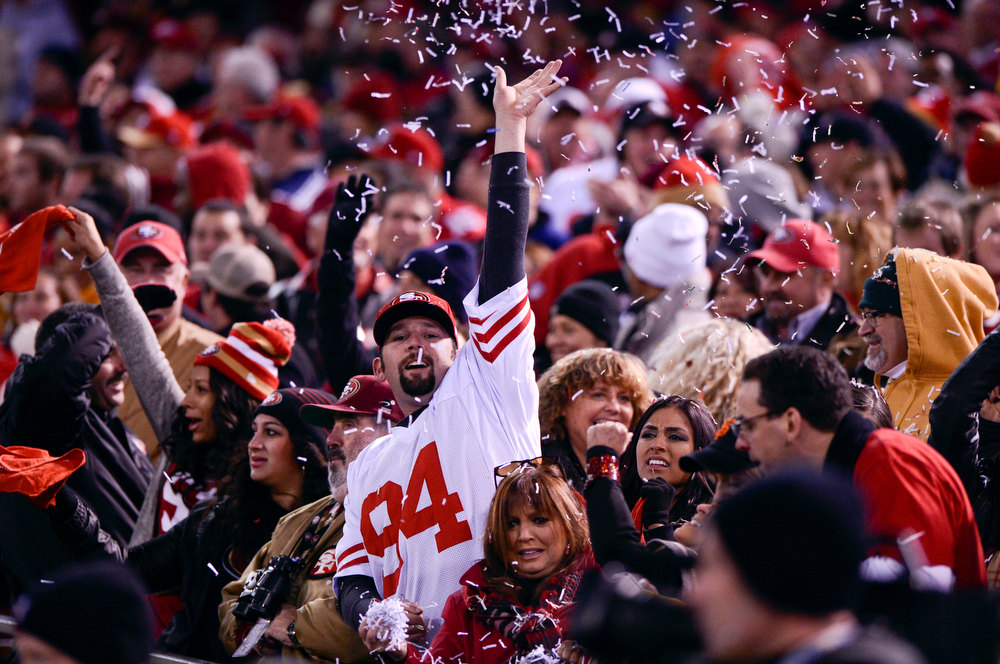 Description of . San Francisco 49ers fans celebrate their team's touchdown during the first quarter against the Green Bay Packers in the NFC Divisional Playoff on Saturday, January 12, 2013, at Candlestick Park in San Francisco, California. (Jose Carlos Fajardo/San Jose Mercury News)