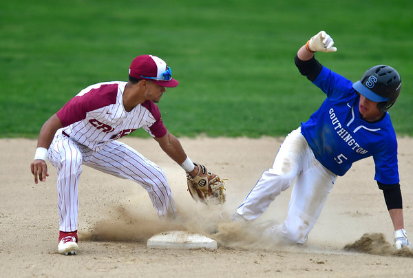4/25/2019 Mike Orazzi | Staff Southington's Jack Meade (5) steals second as New Britain's Justin Adorno (2) applies the late tag during at Bee Hive Stadium in New Britain Thursday.