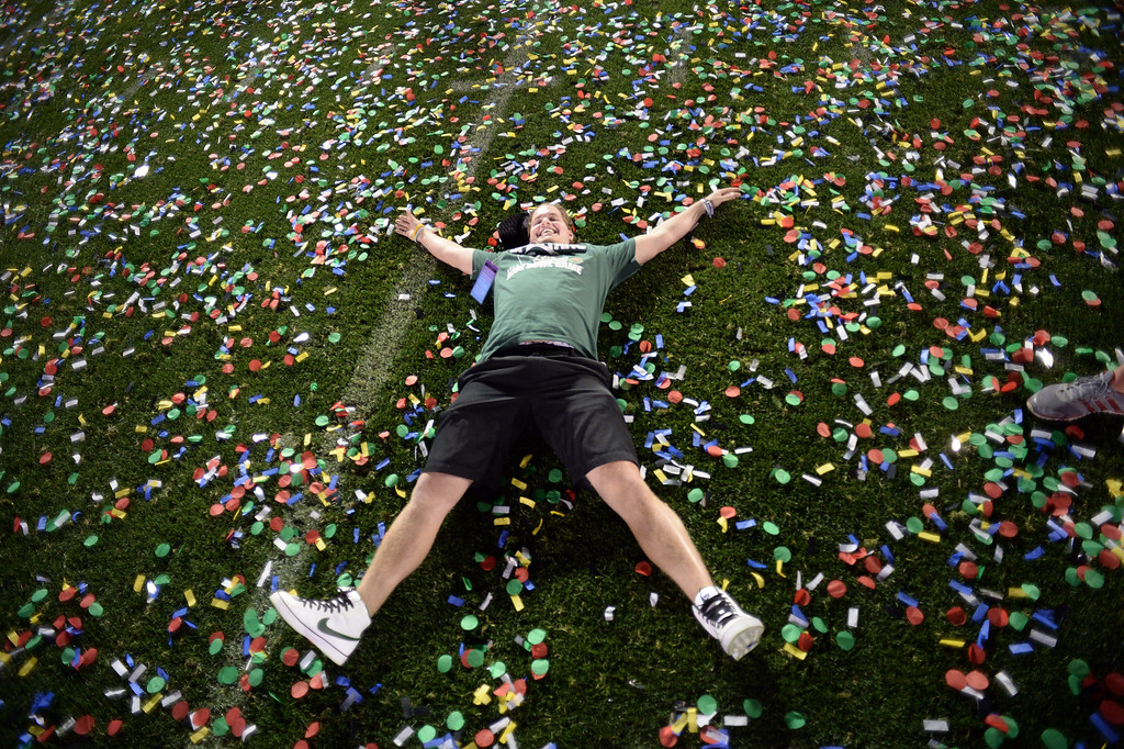 . Michigan State fan Ryan Rafac lays on the field after Michigan State won the 100th Rose Bowl game in Pasadena Wednesday, January 1, 2014. Michigan State defeated Stanford 24-20. (Photo by Hans Gutknecht/Los Angeles Daily News)