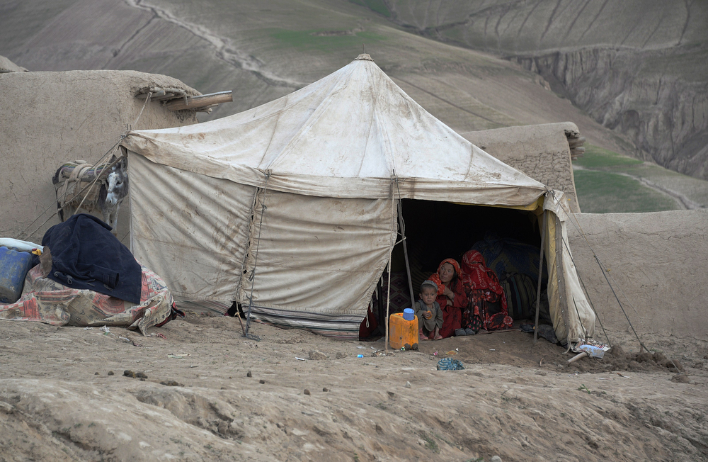 . Afghan villagers look out of their tent at the site of a landslide at the Argo district in Badakhshan on May 3, 2014. Landslides buried a village in northern Afghanistan on Friday, killing at least 350 people and leaving thousands of others feared dead, as rescuers searched desperately for survivors trapped under the mud. Villagers at the disaster site in Badakhshan province used shovels to dig through rocks and dirt, with national authorities, the United Nations and the US-led military force all racing to assess the damage and provide help. (FARSHAD USYAN/AFP/Getty Images)