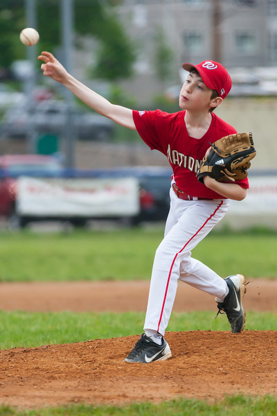 Sam pitching in the bottom of the 1st inning. The Nationals played well both offensively and defensively, and won 10-3 over the Braves. They are now 5-3 for the season. 2012 Arlington Little League Baseball, Majors Division. Nationals vs Braves (08 May 2012) (Image taken by Patrick R. Kane on 08 May 2012 with Canon EOS-1D Mark III at ISO 1600, f2.8, 1/1250 sec and 200mm)