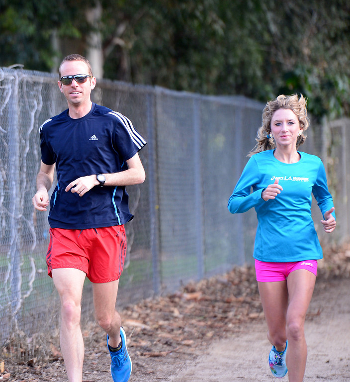 . Aaron Braun and Lauren Kleppin, who both came in second in the 2014 Houston Half Marathon, train for Sunday\'s LA Marathon before a group of elite marathon runners met with students, of the Students Run LA program, at Griffith Park in Los Angeles Friday, March 7, 2014. (Photo by Sarah Reingewirtz/Pasadena Star-News)