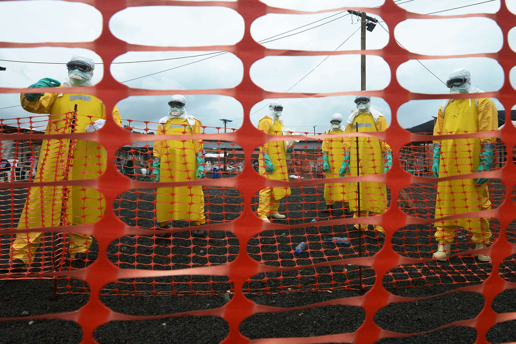 . Workers wearing Personal Protective Equipment (PPE) stand inside the contaminated area at the Elwa hospital run by Medecins Sans Frontieres (Doctors without Borders), on September 7, 2014 in Monrovia.  AFP PHOTO / DOMINIQUE FAGET/AFP/Getty Images